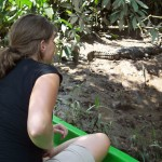 That's me checking out a caiman (like a crocodile) on a Costa Rica riverbank. The boat driver drifted just a little closer than this, and then the caiman jumped into the water (causing me to jump about a mile, too!).